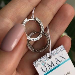 Серебряные серьги кольца с цирконами 001.097 фото