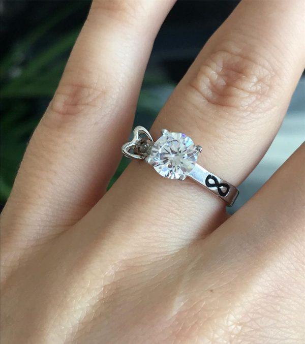 Серебряное кольцо со знаком бесконечности 001.130 фото