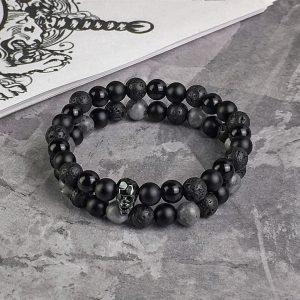 Комплект из двух браслетов MOTION || black & grey larvikite и FACETED SKULL || all black фото